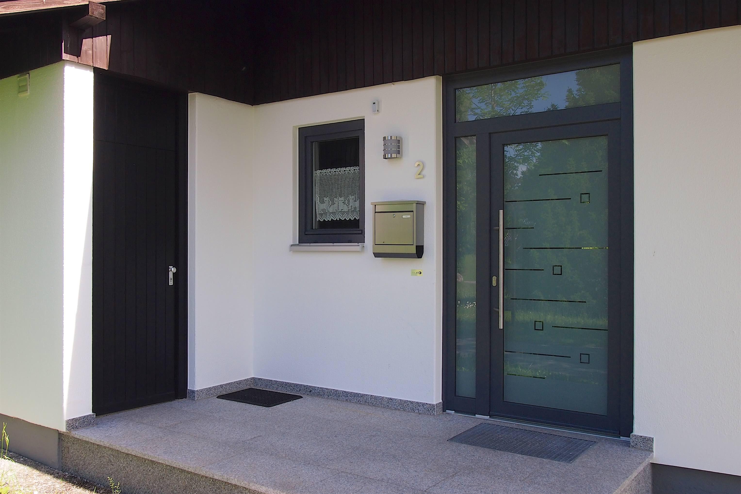 Hauseingang:Der einladend gestaltete Eingangsbereich